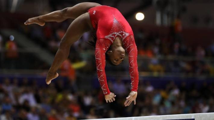 Simone Biles, Novak Djokovic win big
