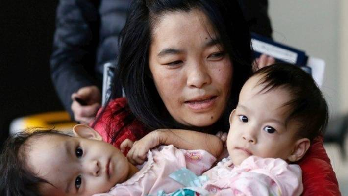 Conjoined Twins Nima And Dawa Pelden Arrive In Melbourne From Bhutan With Their Mother