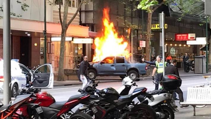 A vehicle can be seen on fire in Bourke Street Melbourne
