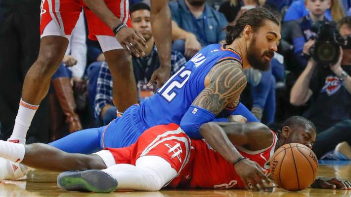 Steven Adams scrambles for possession during the Thunder's win over the Rockets.