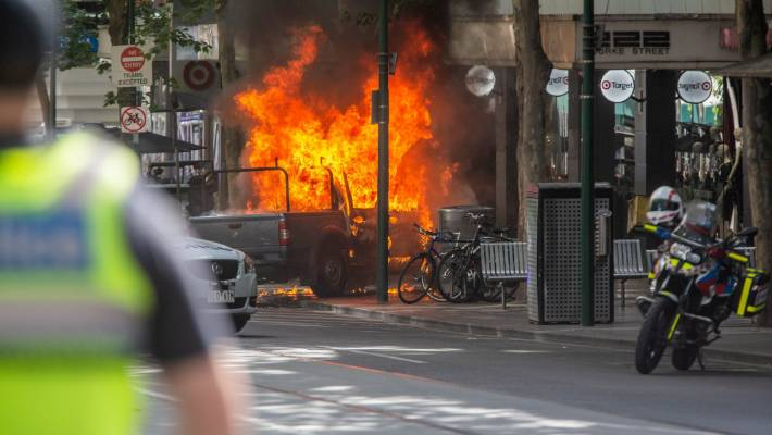 A car on fire in Melbourne's Bourke St during Friday's lone wolf terroristr attack.