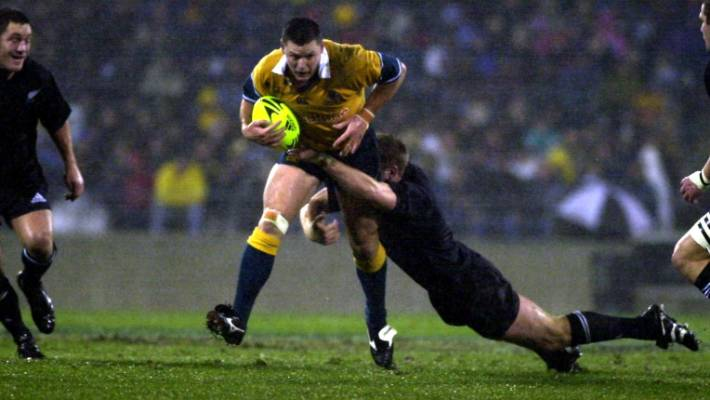 Matt Burke takes on the All Blacks in Christchurch in 2002.