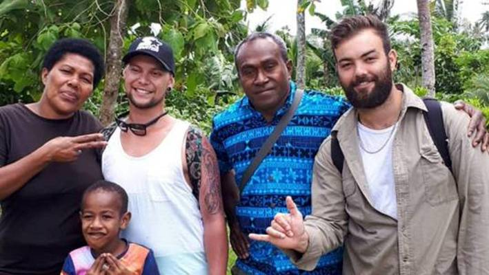 Napier resident Jarred Thompson (second left), who had a cancer battle, felt sick during a trip to Fiji with his friend Thomas Brook (right) in Fiji.