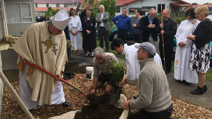 Archbishop Sir David Moxon and planting a commemorative white camelia during a renaming ceremony on October 23.