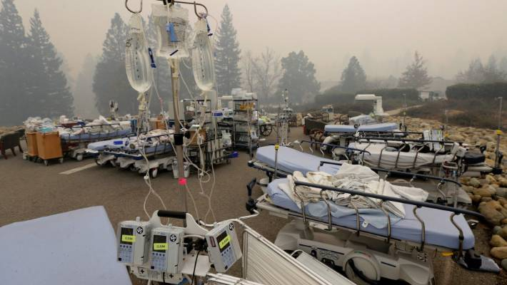 Hospital beds and other equipment sit in a parking lot outside the Feather River Hospital.