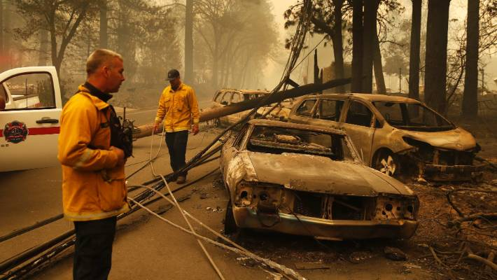 Sonoma Valley firefighters inspect burned out cars to make sure they are clear of human remains.