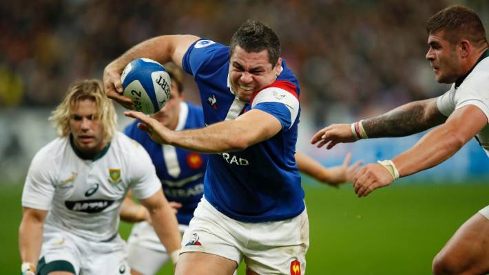 France's Guilhem Guirad passes South Africa's Malcolm Marx to make his team first try.