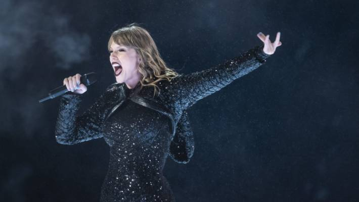 During the downpour that plagued her Auckland show, Taylor Swift paused to clear her nasal passages.