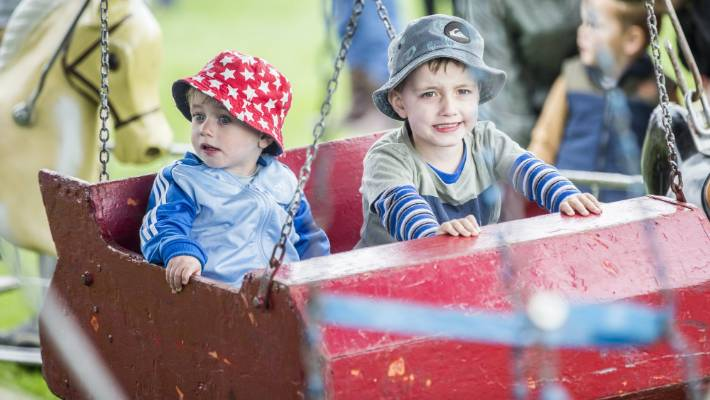 Freddy, 1 and Riley Guildford, 3 enjoy the Merry Go Round at the Marlborough A&P Show.