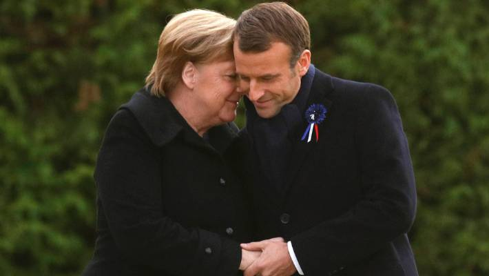 French President Emmanuel Macron and German Chancellor Angela Merkel at an Armistice Day ceremony in the Clairiere of Rethondes.