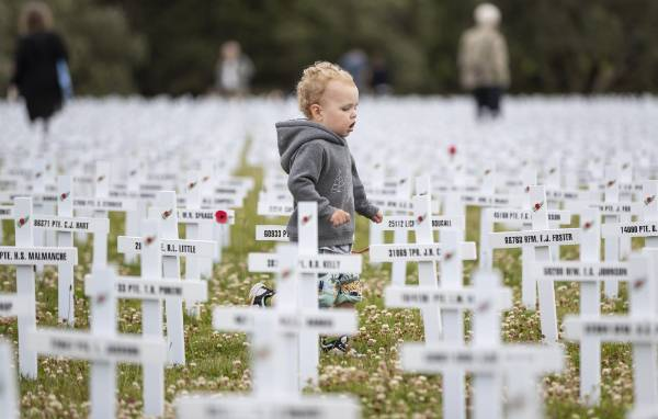 Xavier Cimpoias, 2, before the commemoration commences. Xavier's great great great great uncle has a crossed marked at the cenotaph.