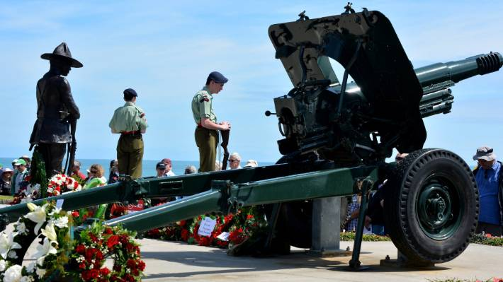 Wreathes around the statue and WW2 howitzer gun.
