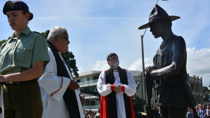 The Reverend Albie Martin and Archbishop Philip Richardson blessing the statue of the soldier.