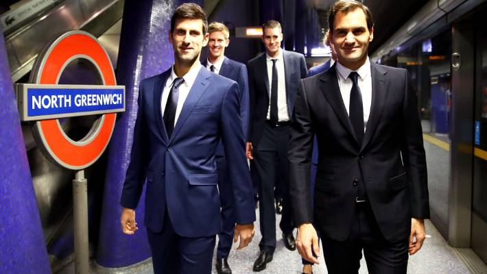 Novak Djokovic, Kevin Anderson John Isner Roger Federer board at London Underground's North Greenwich station