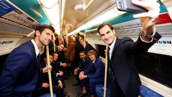 Roger Federer snaps a selfie while Novak Djokovic poses in a London Underground carriage containing eight of the worldl's top 10 tennis players
