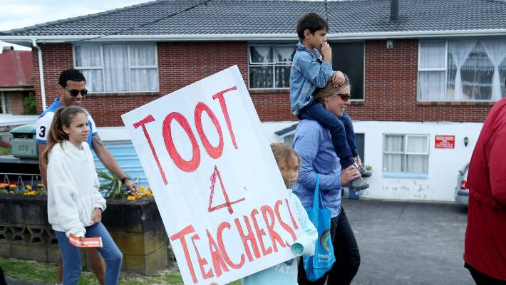 Striking teachers marching through West Auckland have brought their children to the ride.