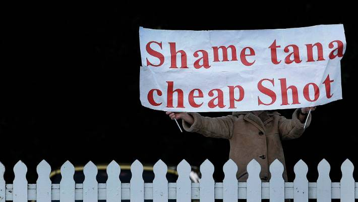 A British and Irish Lioness fanatic holds a banner chastising Tana Umaga at a All Black training session.