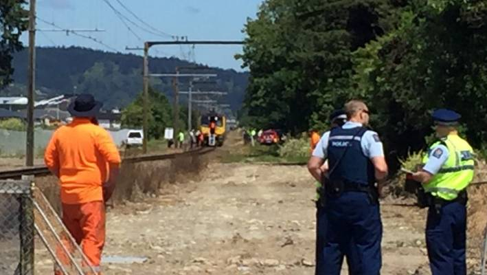 Police near the area where a person died after being struck by a train near Wallaceville, Upper Hutt.