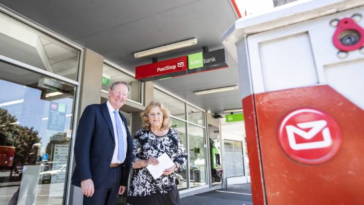 Nick Smith and Christine Tuffnell of Gray Power at the Stoke branch in Kiwibank and NZ Post Putaitai St intends to close.