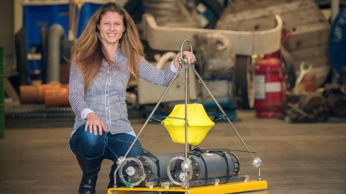 Niwa scientist Dr Kim Goetz with one of the moorings before it was deployed.