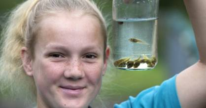 Jenna Tomkinson, 13, has been trying to fetch the tadpoles in an effort to rescue them from a swimming pool.