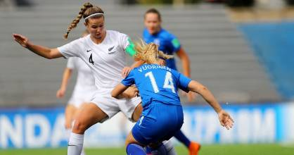 New Zealand captain Aneka Mittendorff challenges a Finnish opponent during their opening game.