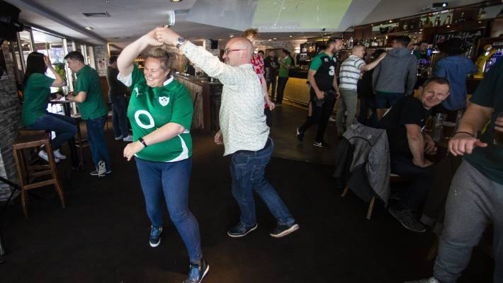 Irish supporters at the D4 bar in Wellington celebrate Ireland's victory over the All Blacks.