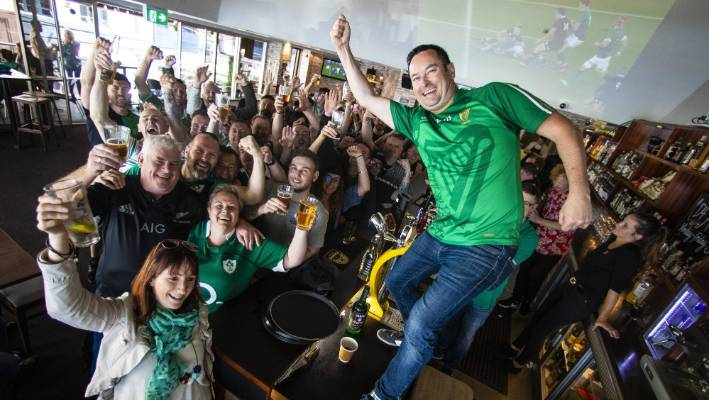 D4 in Featherston St owner Dermot Murphy celebrates with punters following Ireland's victory over the All Blacks.