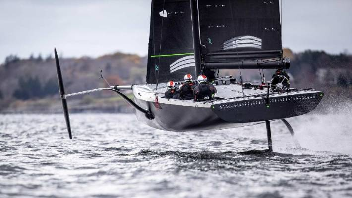 Dean Barker at the helm of American Magic's foiling monohull test boat ahead of the 2021 America's Cup.