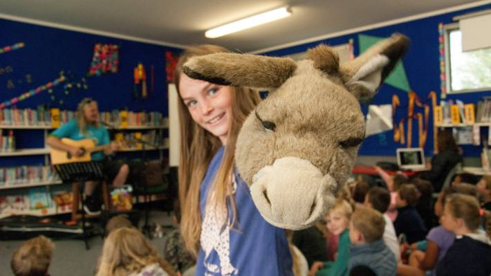 Gabby Pine, 8, will take the stage at Wairau Valley School with a Wonky Donkey puppet writer Craig Smith.