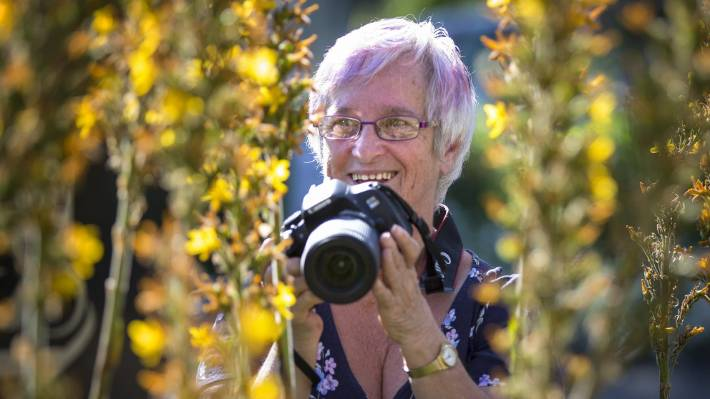 From where I am sitting, is a demonstration of photography that invites people to see things from a wheelchair perspective. Maureen Jensen is an organizer and participant.