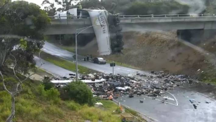 truck left dangling on overpass after crash shuts busy freeway north