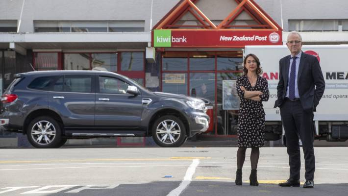 Workers Ginny Andersen and Greg O'Connor stay outside the Peton NZ Post store / Kiwibank branch of Jackson Street in Petone. The starting point is proposed to close together with others across the country.