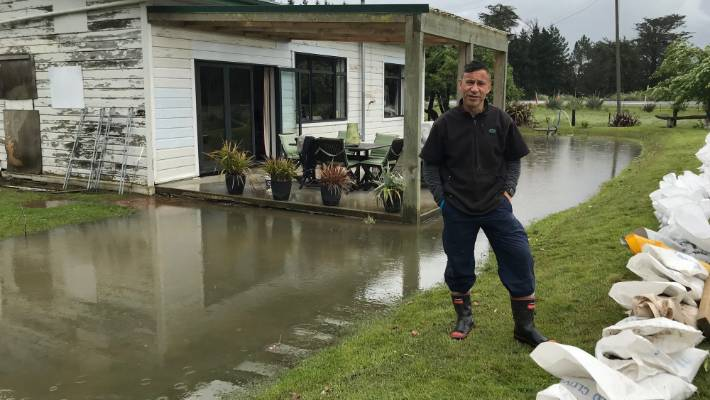 Paul Skipper, of Milton, used sandbags and pumps to prevent water from entering his home.