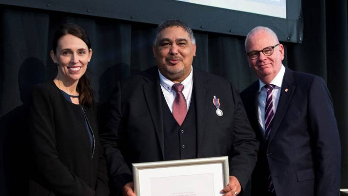 Kyle Kuiti with Prime Minister Jacinda Ardern and State Services Commissioner Peter Hughes.
