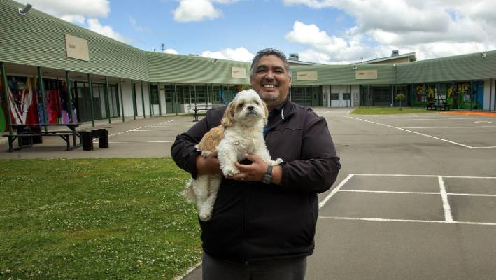 Kyle Kuiti has been awarded a Public Service Model for his work with youth in the justice system. Kyle with his pet dog, named Tiki Taane, at Te Au rere a te Tonga Youth Justice Residence in Palmerston North. He takes the dog to work every day.
