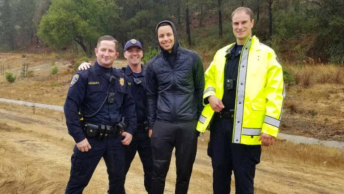 Stephen Curry second from right poses with CHP Officers after two drivers hit Curry's car on in Oakland California