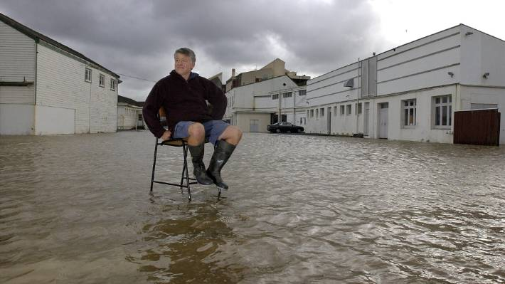 Allan Hyslop, a Wellington Greyhound Racing Club committee member, ponders the cancellation of races at Hutt Park due to flooding in 2003.
