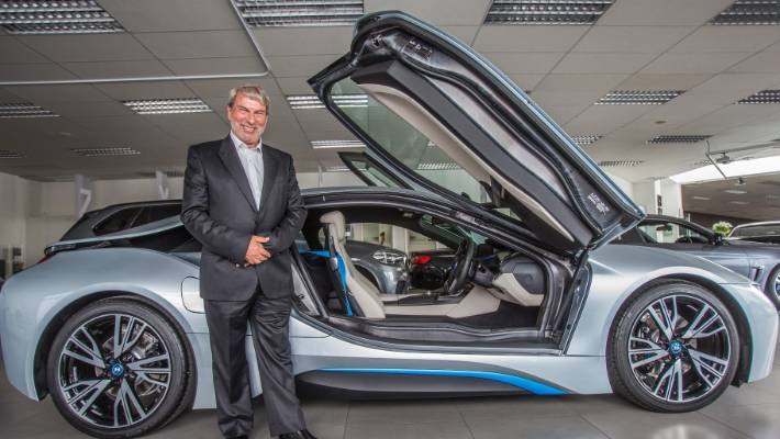 Tracy Gough with one of his recent collections - an i8 BMW.