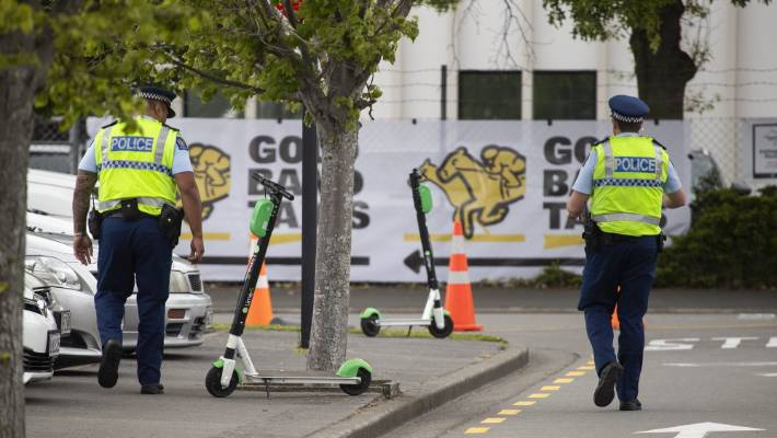 The police pass Lime scooters at the main entrance of the Addington Circuit on New Zealand Trotting Cup Day during the NZ Cup and the Show Week.