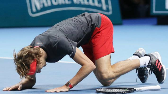 Alexander Zverev slumps to the court after beating Novak Djokovic of Serbia in their ATP World Tour Finals singles final.