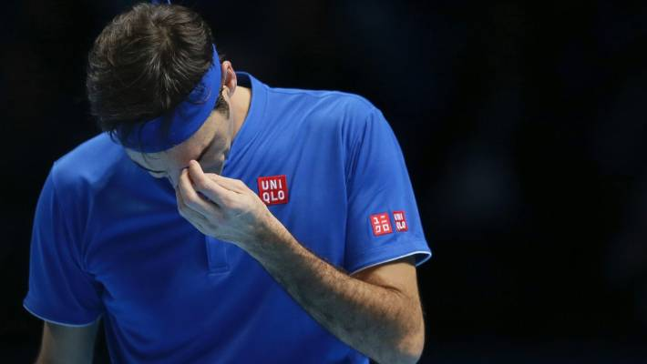 Roger Federer of Switzerland looks dejected after losing a point to Alexander Zverev.