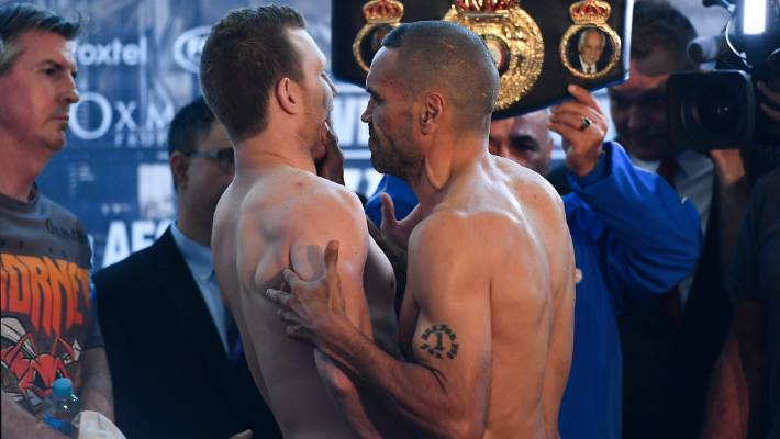 Anthony Mundine, right, grabbed Jeff Horn for weighing for Friday's match in Brisbane.