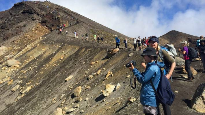 If you're hoping to feel at one with nature, the Tongariro Crossing is probably not the best tramp to choose.