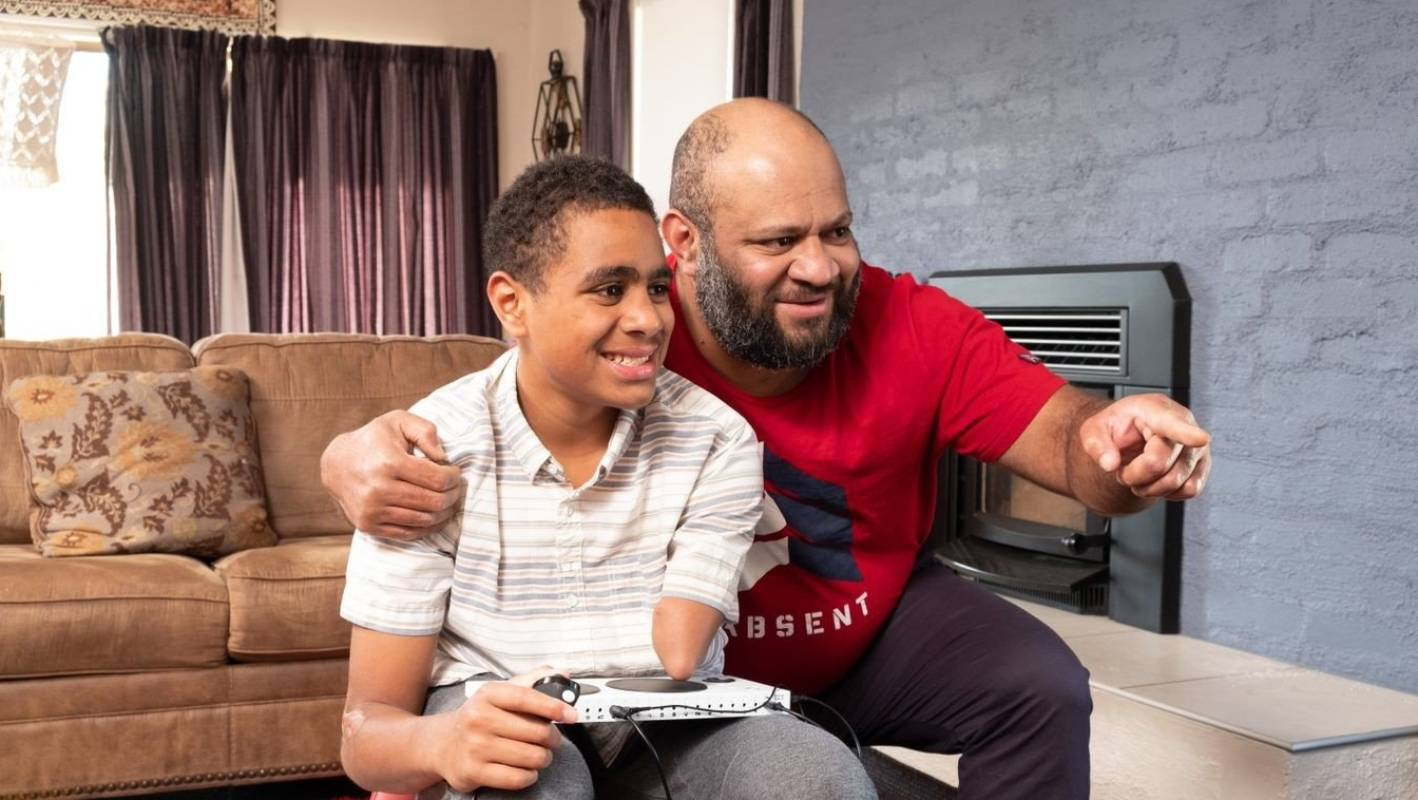 Amputee Sai Daunibau, 14, can finally video game with his friends due to a new 'adaptable' Xbox controller designed with and for people with disabilities.