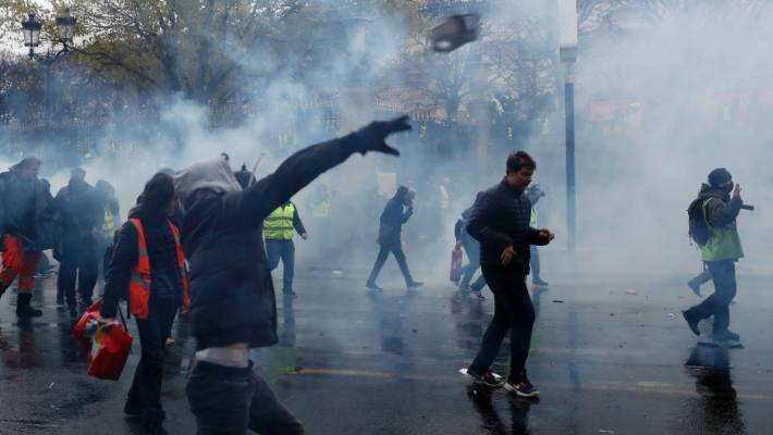 Protesters angry about rising taxes clashed with French police for a third straight weekend