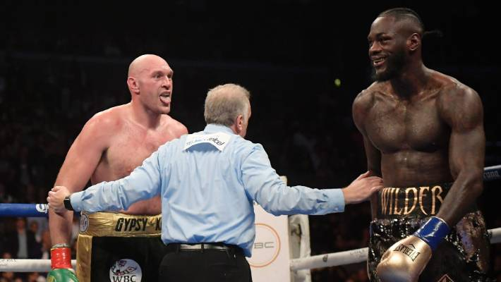 Tyson Fury and Deontay Wilder couldn't be separated on points as they fought an exciting draw in the WBC world heavyweight title clash in Los Angeles