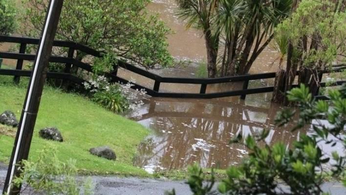 Flooding in Glenesk Valley, Piha.