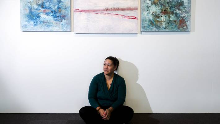 Ana Mihaere, with her paintings that are part of the Women's Art Initiative exhibition at Te Manawa.