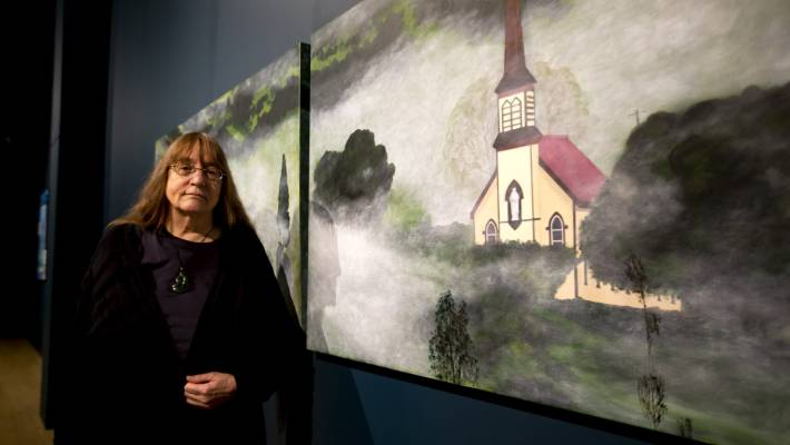 Pam Vernon's paintings and mixed media works are exhibited in the same room as her son's and just around the corner from her daughter's art.